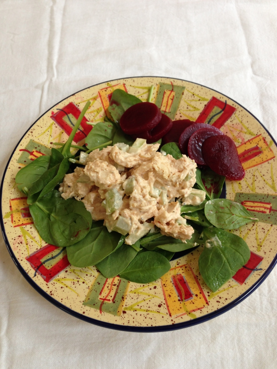 Homemade chicken salad on baby spinach with pickled beets